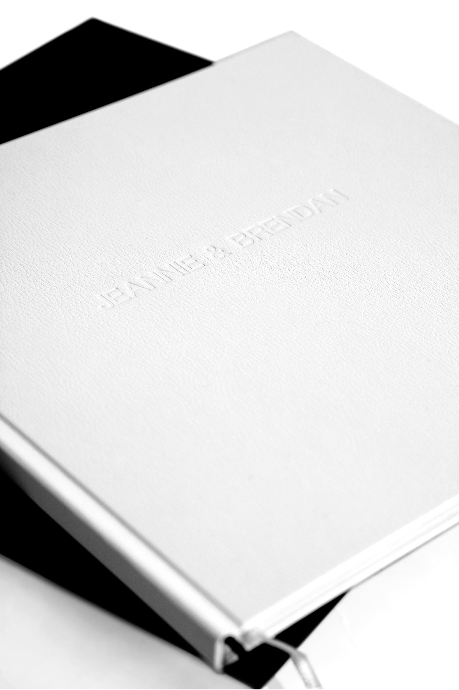 Cover of Queensberry book white genuine leather and embossed names