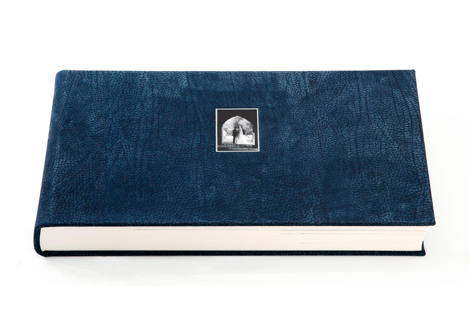 A large 10x18 inch Queensberry Duo album with a cover in Blueberry Contemporty genuine leather and square photograph