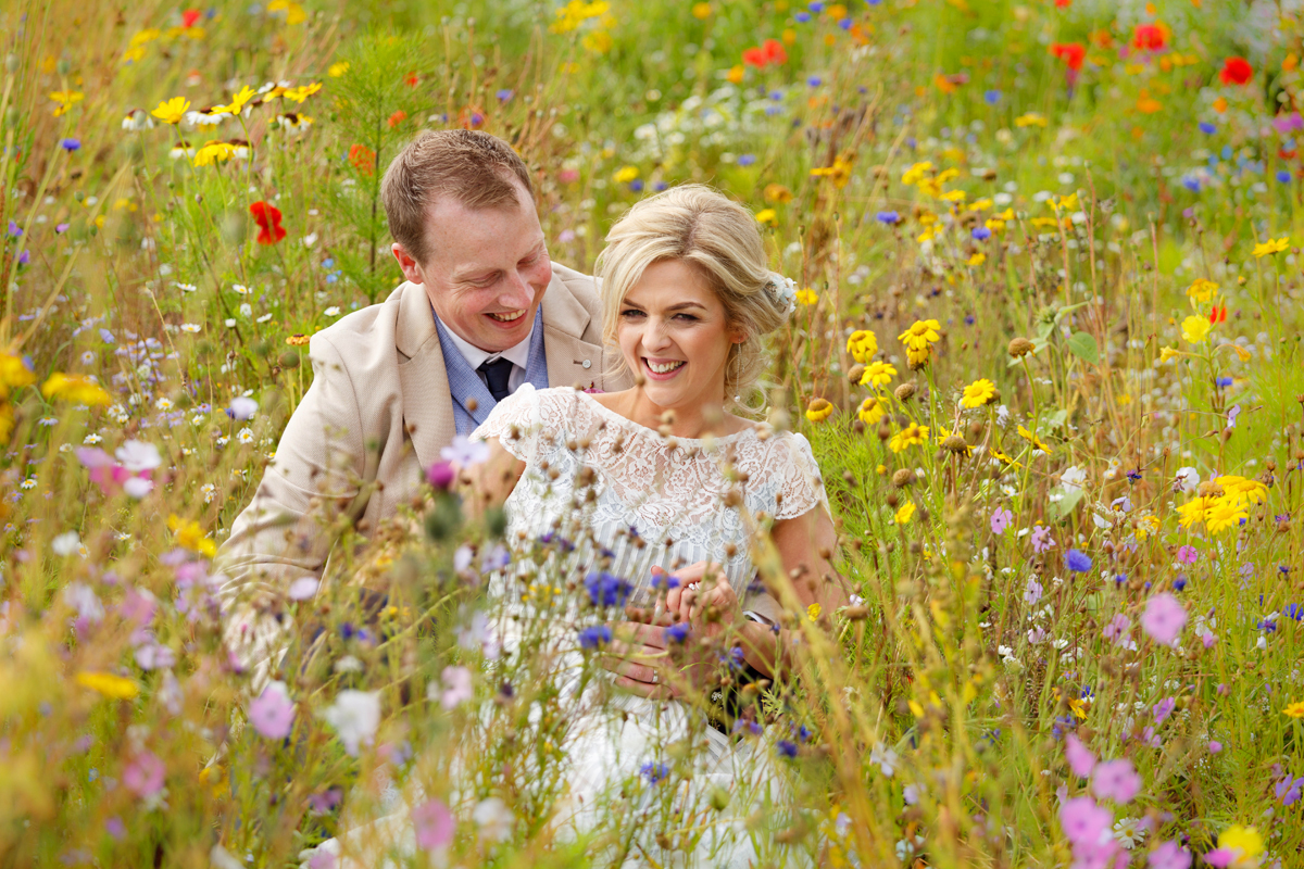 relaxed wedding photography in a field of flowers